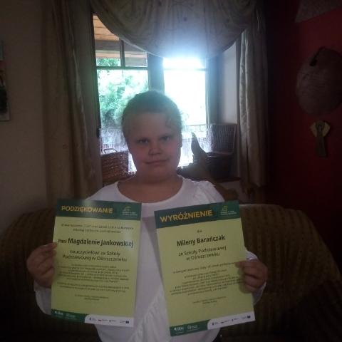 Milena z dyplomami